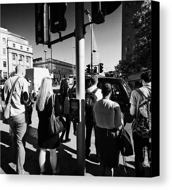 Early Canvas Print featuring the photograph early morning commuters waiting to cross the road pedestrian crossing London England UK by Joe Fox