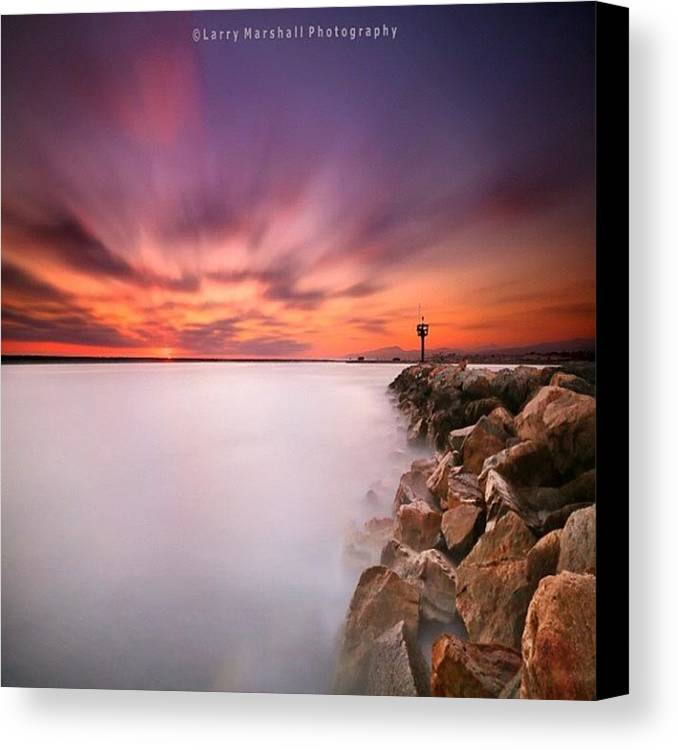 Canvas Print featuring the photograph Long Exposure Sunset Shot At A Rock by Larry Marshall