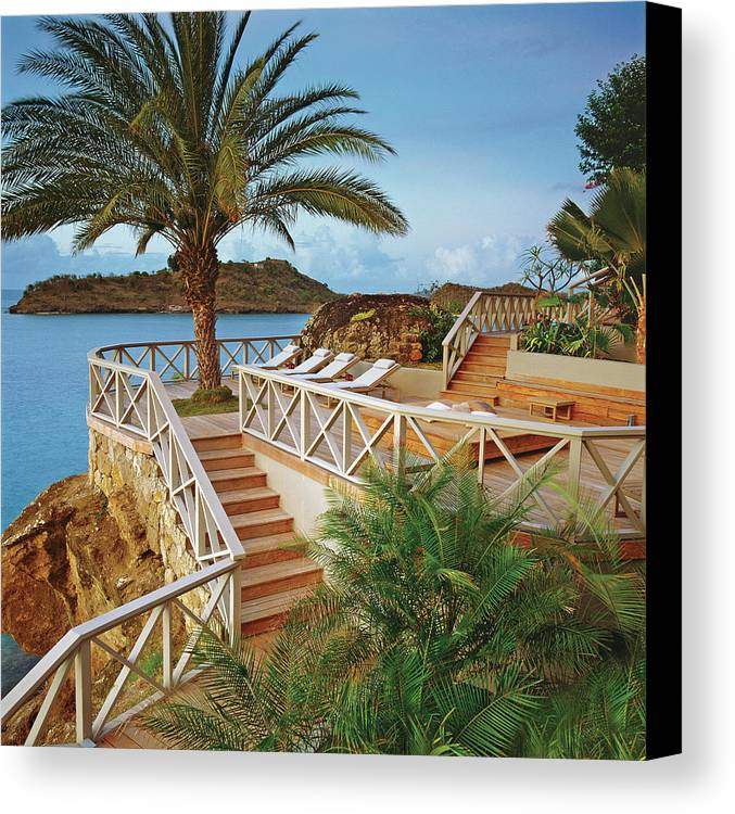 seaside resort with stairs and palm tree canvas print canvas art
