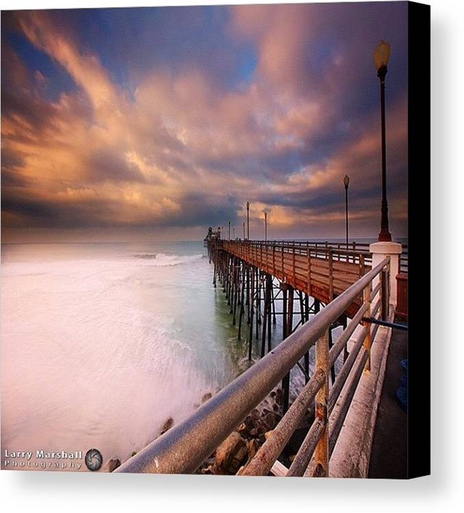 Canvas Print featuring the photograph Long Exposure Sunset At The Oceanside by Larry Marshall