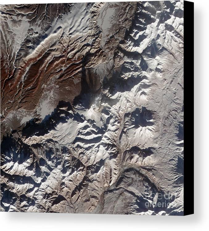 Mountainous Canvas Print featuring the photograph Satellite Image Of Russias Kizimen by Stocktrek Images