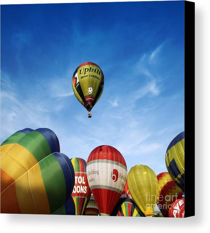 Balloon Fiesta Canvas Print featuring the photograph Balloons by Angel Ciesniarska