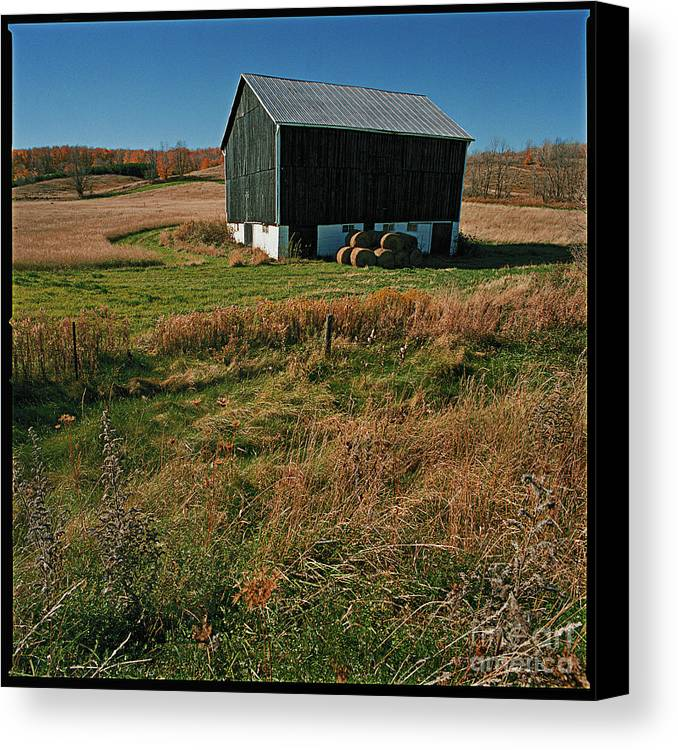 Landscape Country Autumn Fall Color Barn Canvas Print featuring the photograph A Barn In Mid Autumn by Ty Lee