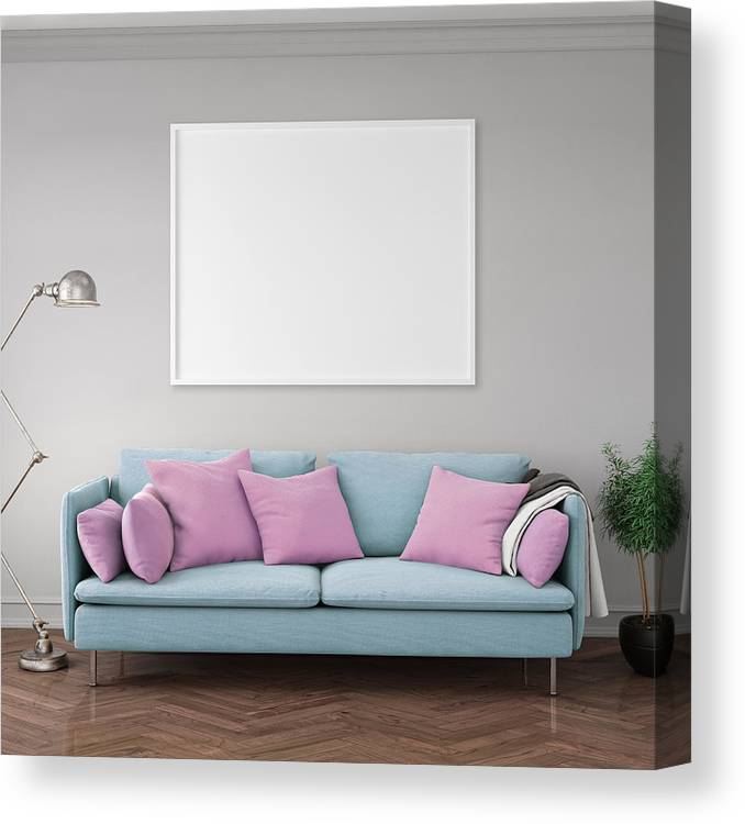 Pastel Colored Sofa With Blank Wall Template Canvas Print