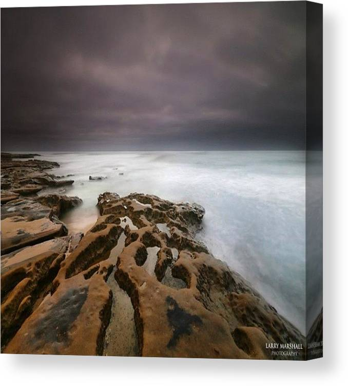 Canvas Print featuring the photograph Long Exposure Sunset On A Dark Stormy by Larry Marshall