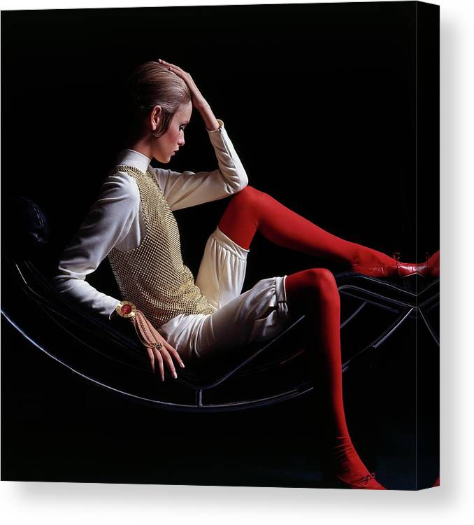 Accessories Canvas Print featuring the photograph Twiggy Sitting On A Modern Chair by Bert Stern