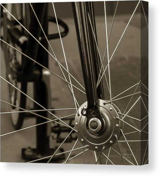 Spokes Canvas Print featuring the photograph Urban Spokes In Sepia by Steven Milner