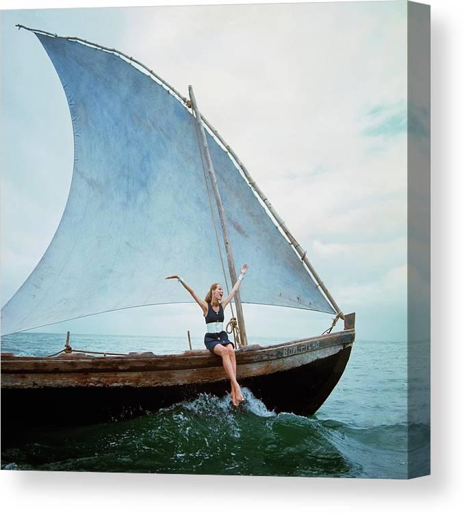 Boat Canvas Print featuring the photograph Veruschka Von Lehndorff Sitting On Edge by Franco Rubartelli
