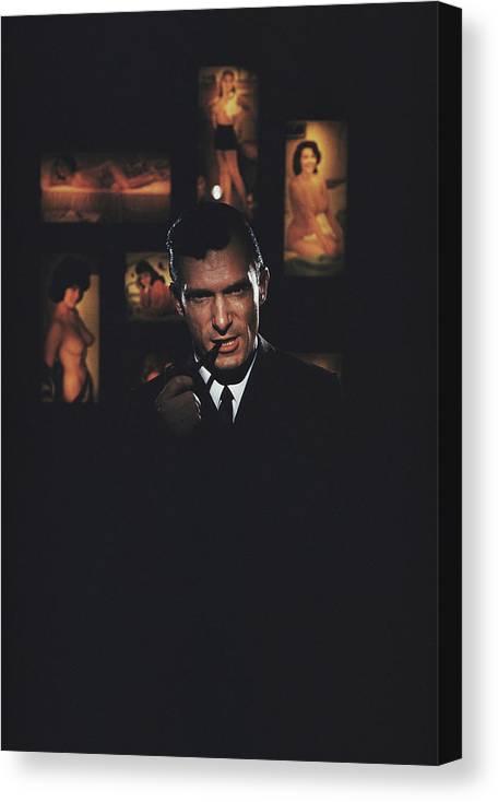 Hugh Hefner Canvas Print featuring the photograph Hugh Hefner by Slim Aarons