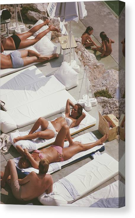 Recreational Pursuit Canvas Print featuring the photograph Sunbathers At Eden Roc by Slim Aarons