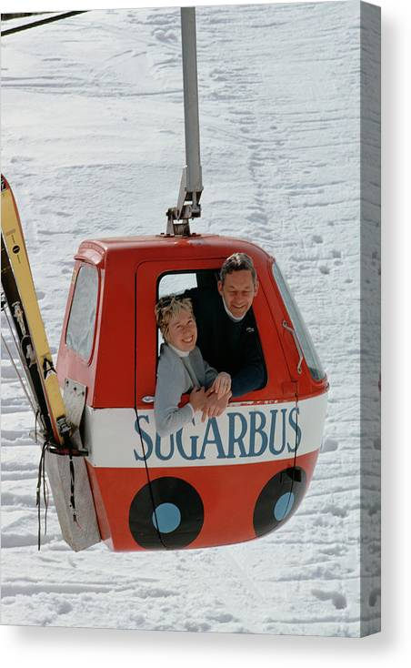 People Canvas Print featuring the photograph Snow Lift by Slim Aarons