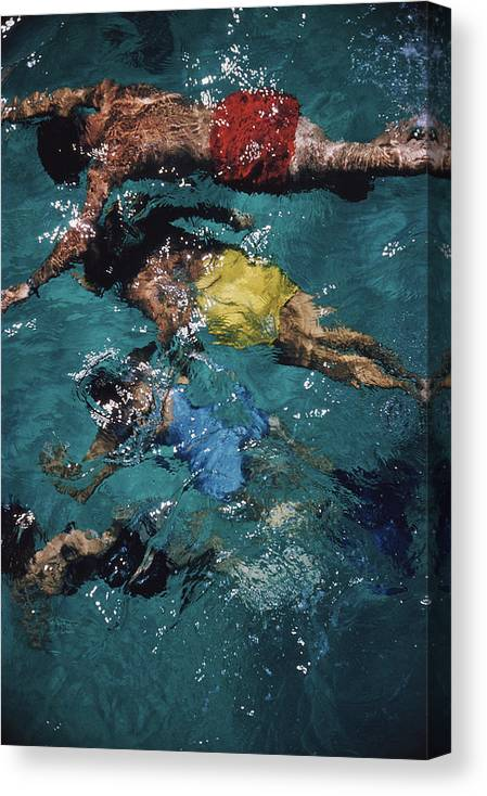 People Canvas Print featuring the photograph Swimming In The Bahamas by Slim Aarons