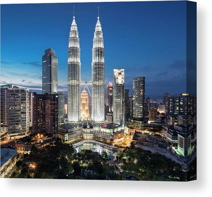 Downtown District Canvas Print featuring the photograph Malaysia, Kuala Lumpur, Petronas Towers by Martin Puddy