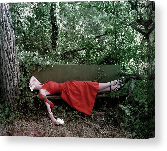Accessories Canvas Print featuring the photograph A Woman Lying On A Bench by John Rawlings