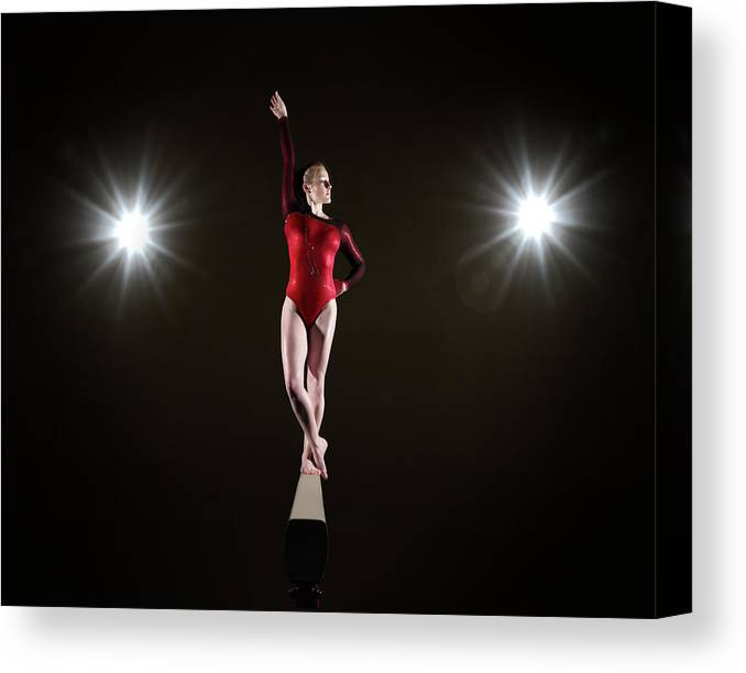Human Arm Canvas Print featuring the photograph Female Gymnast On Balancing Beam by Mike Harrington