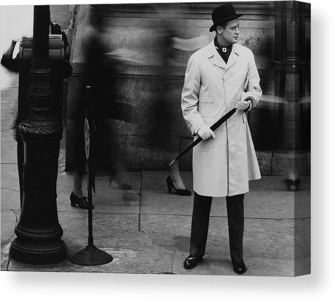 Exterior Canvas Print featuring the photograph Man Wearing A Raincoat by John Rawlings