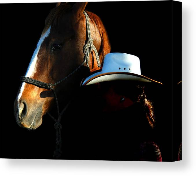 A Woman Wrangler And Her Horse Pose Together While On The White Horse Ranch In Southeastern Oregon. Canvas Print featuring the photograph Oregon by Lourie Zipf