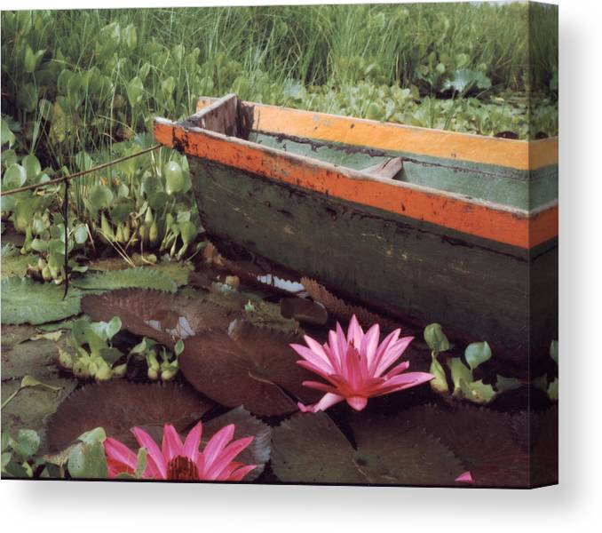 Boat Canvas Print featuring the photograph Colombian Boat and Flowers by Lawrence Costales