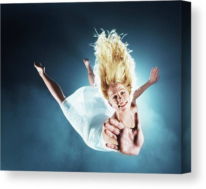 Human Arm Canvas Print featuring the photograph Young Woman In Air, Arms Outstretched by Henrik Sorensen
