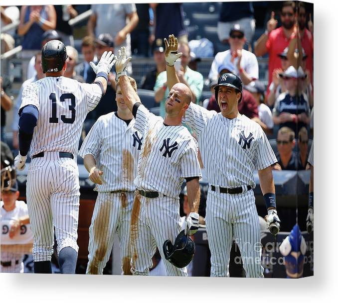 Three Quarter Length Canvas Print featuring the photograph Kansas City Royals V New York Yankees by Al Bello