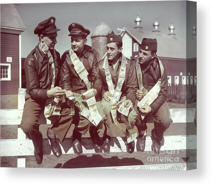 Young Men Canvas Print featuring the photograph Air Force Gunners Comparing Short by Bettmann