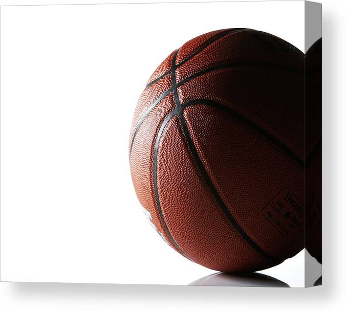 Recreational Pursuit Canvas Print featuring the photograph Basketball On White Background by Thomas Northcut