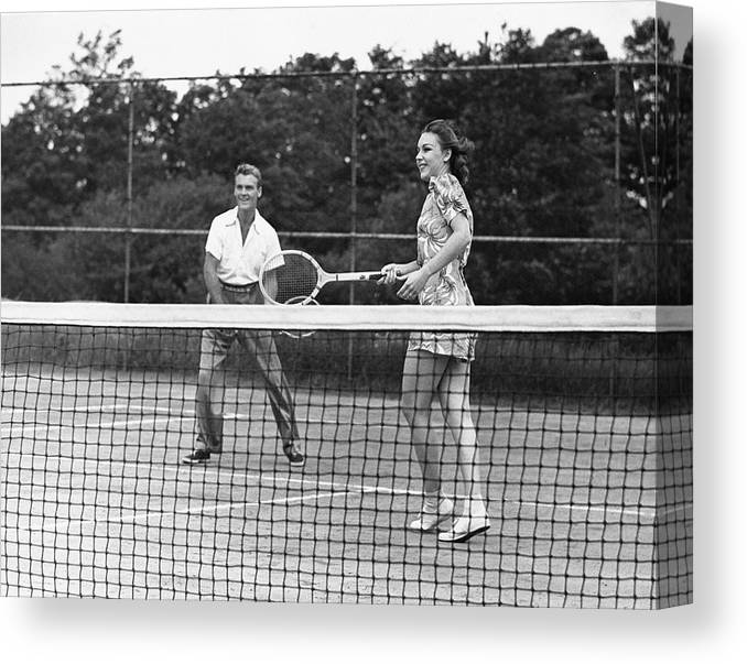 Heterosexual Couple Canvas Print featuring the photograph Couple Playing Tennis by George Marks