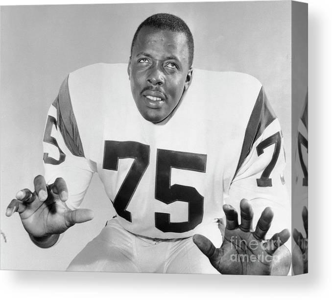 American Football Uniform Canvas Print featuring the photograph Dave Deacon Jones by Bettmann