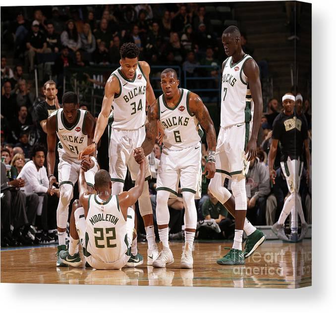 Assistance Canvas Print featuring the photograph Denver Nuggets V Milwaukee Bucks by Nba Photos
