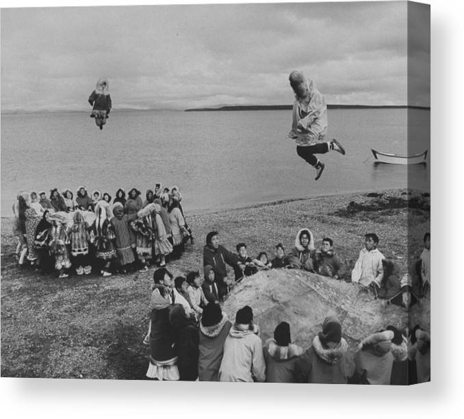 Timeincown Canvas Print featuring the photograph Eskimos Using Homemade Trampolines To Ce by Ralph Crane