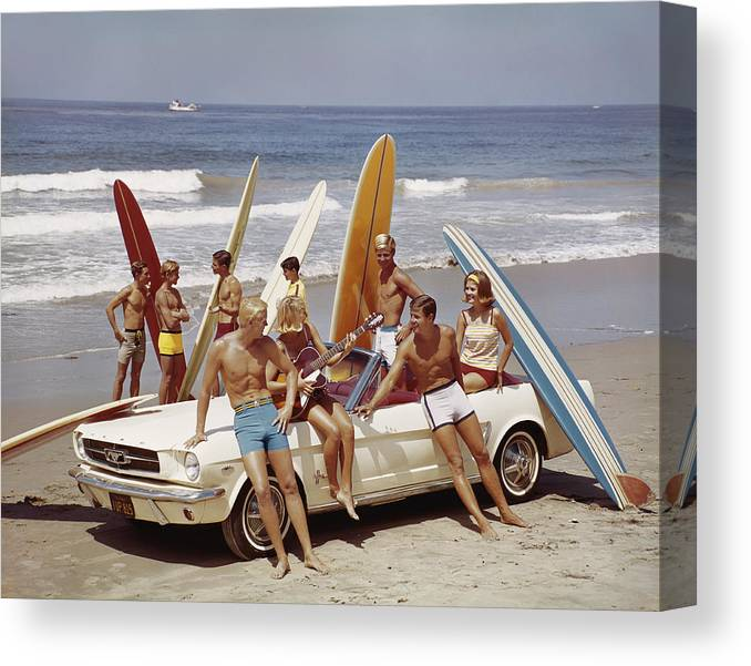 Young Men Canvas Print featuring the photograph Friends Having Fun On Beach by Tom Kelley Archive
