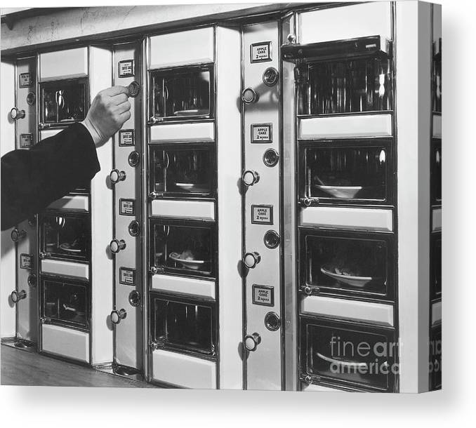 Coin Canvas Print featuring the photograph Hand Placing Coin Into Automat Lunch by Bettmann