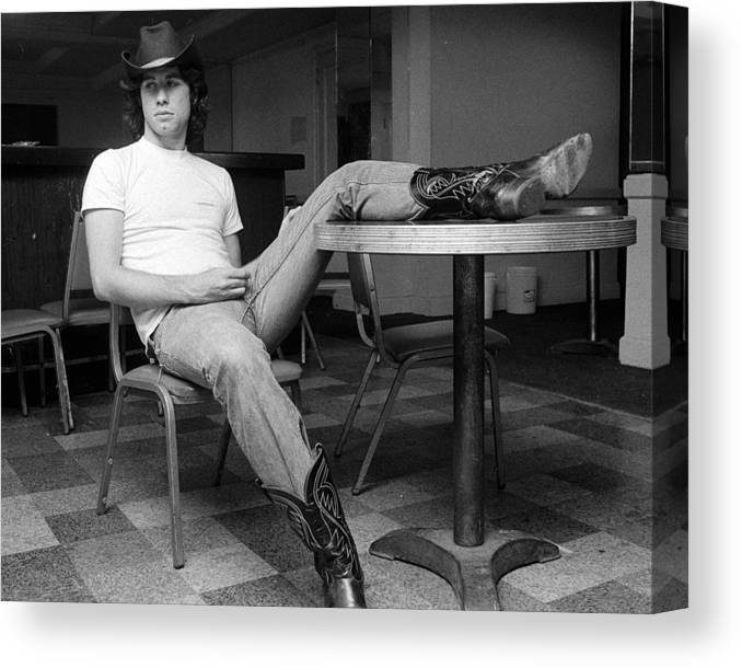 John Travolta Canvas Print featuring the photograph John Travolta, With His Hat And Boots by New York Daily News Archive