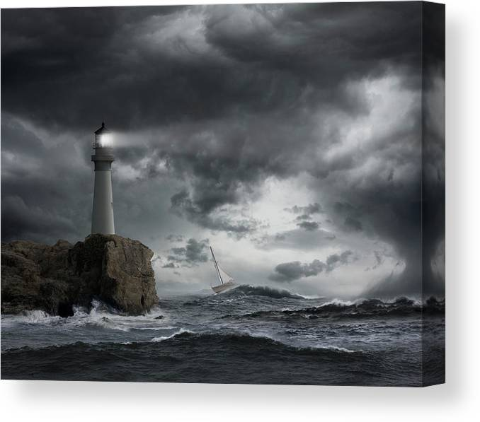 Risk Canvas Print featuring the photograph Lighthouse Shining Over Stormy Ocean by John M Lund Photography Inc