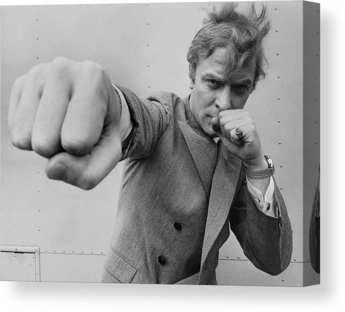 Michael Caine Canvas Print featuring the photograph Michael Caine Throwing A Punch by Stephan C Archetti