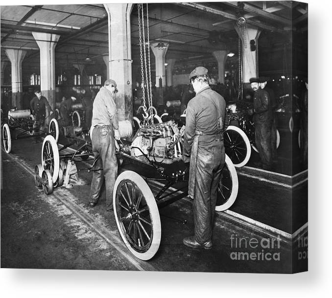 Working Canvas Print featuring the photograph Model T Being Assembled In Ford Plant by Bettmann