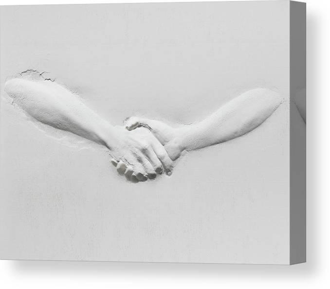 Human Arm Canvas Print featuring the photograph Relief Of Handshake by Henrik Sorensen