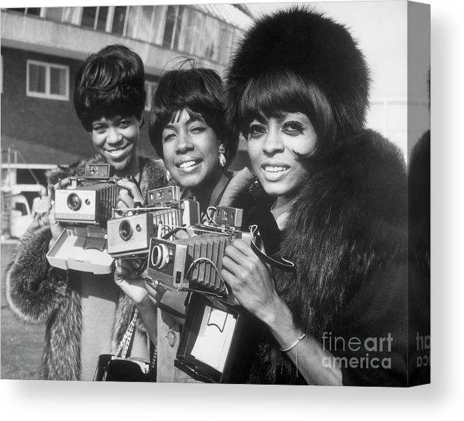 Singer Canvas Print featuring the photograph The Supremes With Cameras In London by Bettmann