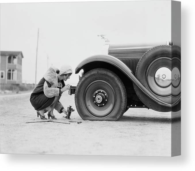 People Canvas Print featuring the photograph Woman Changing Flat Tire On Car by H. Armstrong Roberts