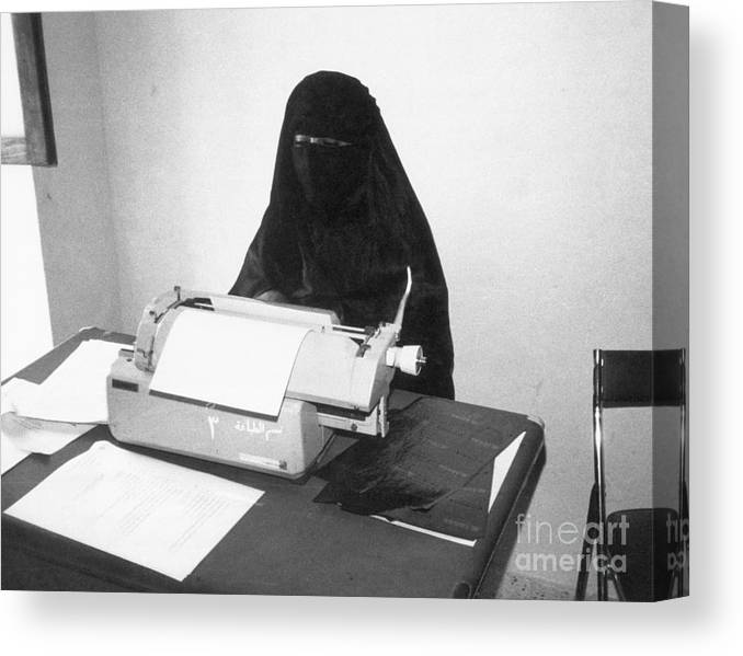 Working Canvas Print featuring the photograph Yemeni Woman Typing In Chador And Veil by Bettmann