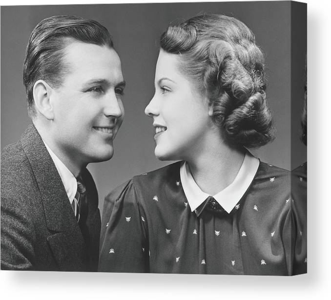 Young Men Canvas Print featuring the photograph Young Couple Looking In Eyes In Studio by George Marks