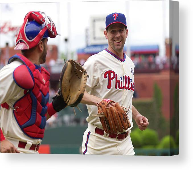 Baseball Catcher Canvas Print featuring the photograph Cliff Lee and Wil Nieves by Mitchell Leff