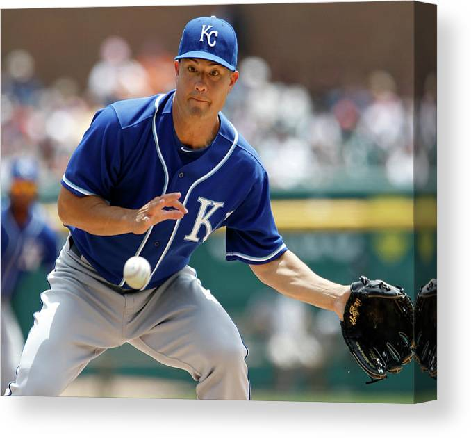 American League Baseball Canvas Print featuring the photograph Jeremy Guthrie and Rajai Davis by Duane Burleson