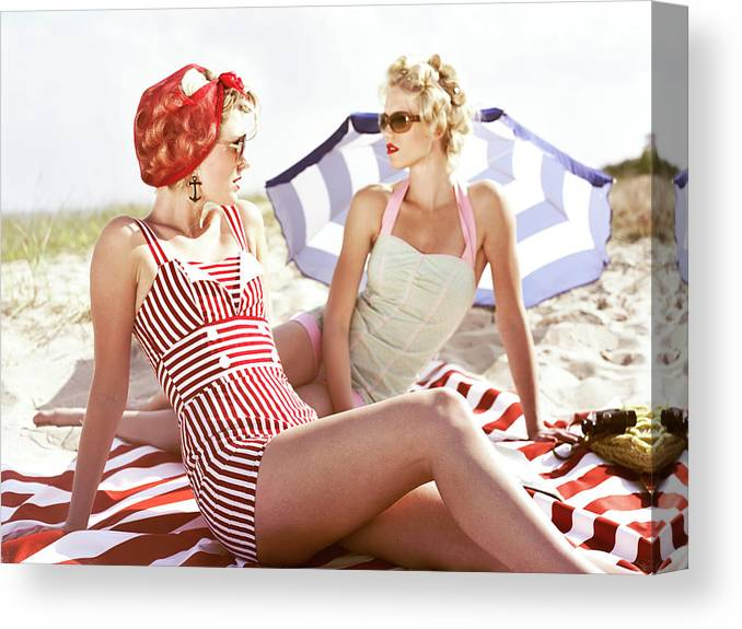 Three Quarter Length Canvas Print featuring the photograph Two Retro Young Women On Beach by Johner Images