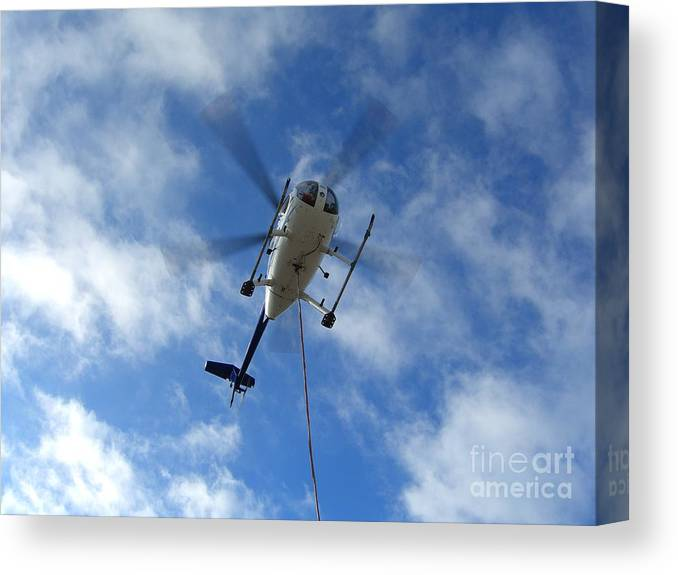 Helicopter Canvas Print featuring the photograph Helicopter Hover by Jim Thomson