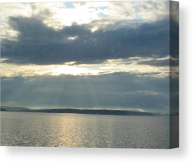 Clouds Canvas Print featuring the photograph Sun Rays thru Cloudy Sky by Valerie Josi