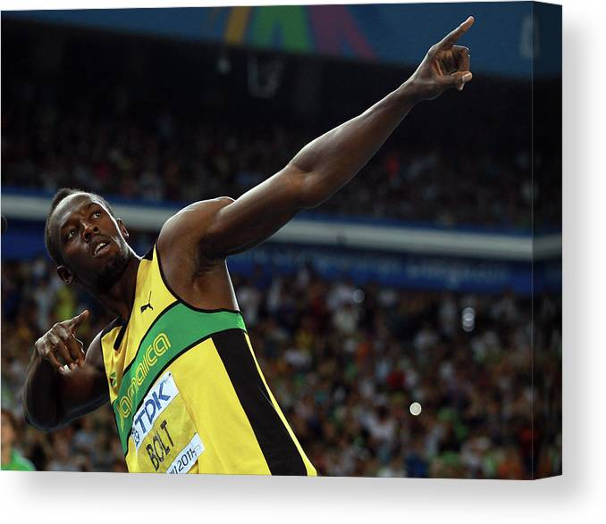 Usain Bolt 'to Di World' Pose Canvas Print featuring the photograph 13th Iaaf World Athletics Championships by Alexander Hassenstein