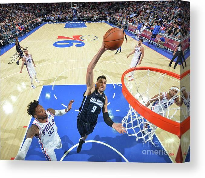 Nba Pro Basketball Canvas Print featuring the photograph Philadelphia 76ers V Orlando Magic by Jesse D. Garrabrant