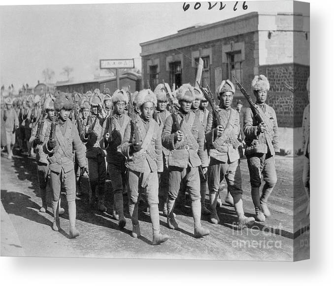 Marching Canvas Print featuring the photograph Chinese Soldiers Marching With Weapons by Bettmann