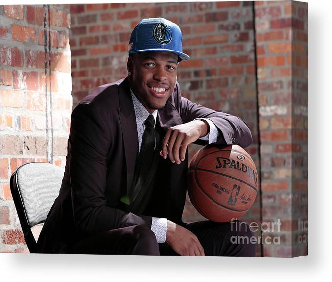 Nba Pro Basketball Canvas Print featuring the photograph Dallas Mavericks Introduce Dennis Smith by Glenn James